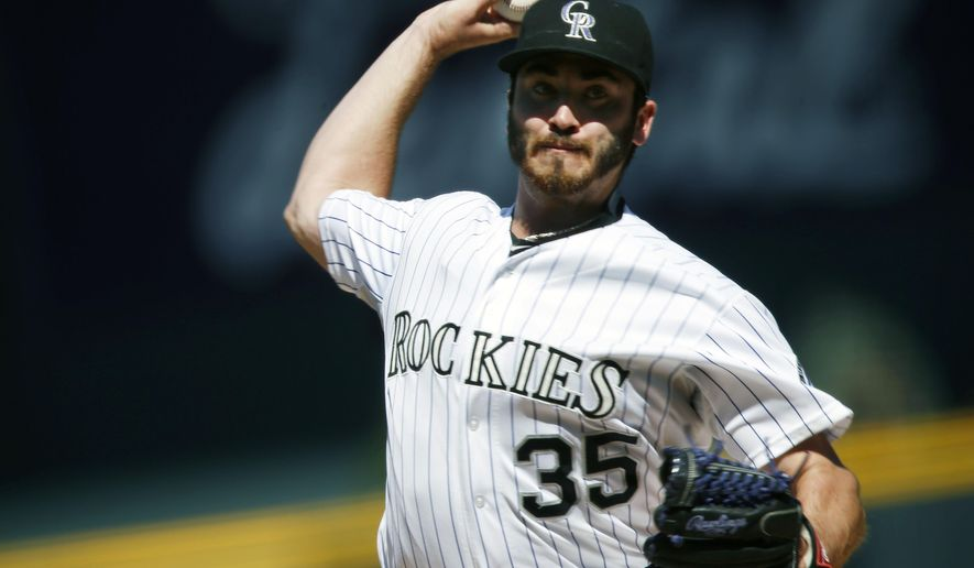 Colorado Rockies starting pitcher Chad Bettis works against the Pittsburgh Pirates in the first inning of a baseball game Thursday, Sept. 24, 2015, in Denver. (AP Photo/David Zalubowski)