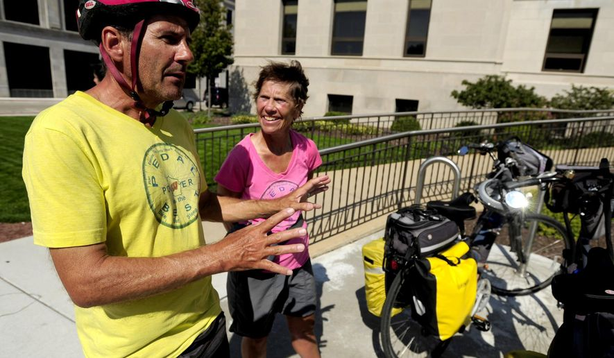 ADVANCED FOR RELEASE MONDAY, SEPTEMBER 28, 2015 Ray Resch and his wife Jo, of Madison, stop by Kenosha on a bicycle tour of the county seats in the state. (Kevin Poirier/Kenosha News via AP)