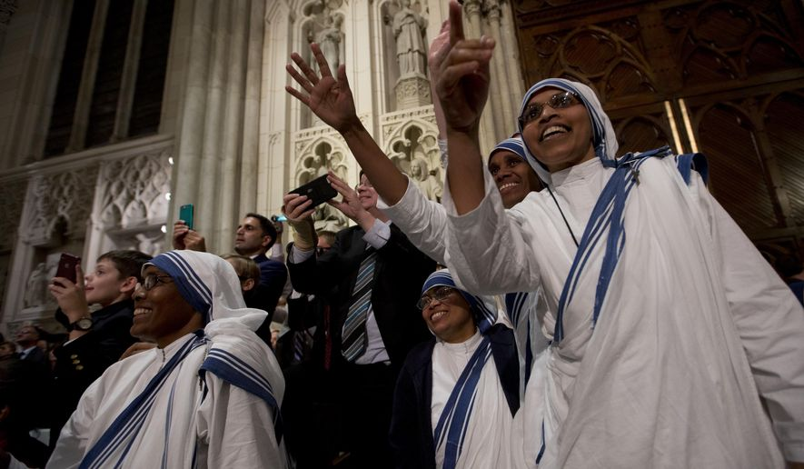 Nuns looks at Pope Francis as he enters St. Patrick's Cathedral to lead an evening prayer service Thursday, Sept. 24, 2015, in New York. (AP Photo/Alessandra Tarantino)