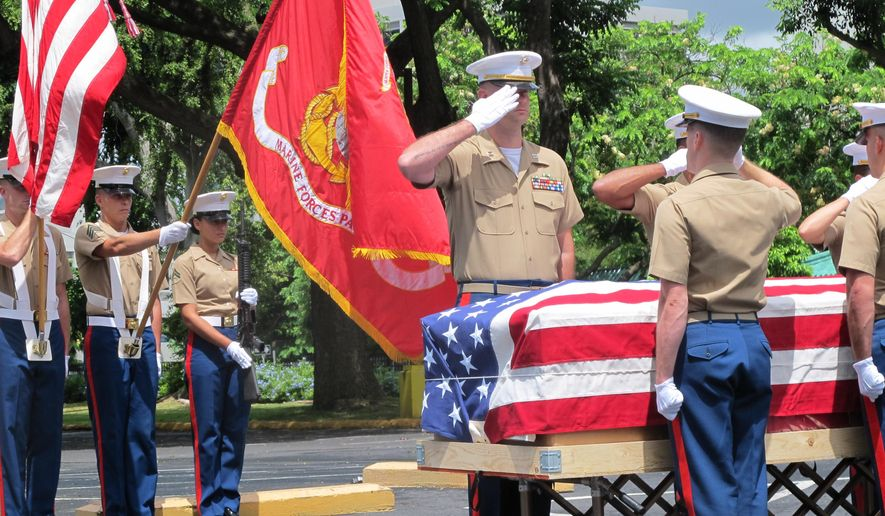 United States Marines salute during a Thursday, Sept. 24, 2015, ceremony in Honolulu for the departure of 1st Lt. Alexander Bonnyman's remains. The recently identified remains of Bonnyman who was hailed for his bravery in battle are heading home 72 years after he was killed on a remote Pacific atoll during World War II. (AP Photo/Audrey McAvoy)