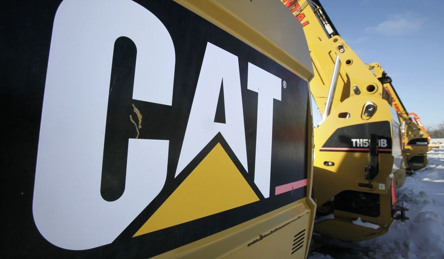 This Jan. 26, 2010, file photo shows Caterpillar equipment available at the Ziegler CAT dealer, in Altoona, Iowa. Caterpillar on Thursday, Sept. 24, 2015, said it is cutting as many as 5,000 jobs as the construction and mining equipment maker pushes to reduce costs while dealing with downturns in key markets that it serves. (AP Photo/Charlie Neibergall, File)