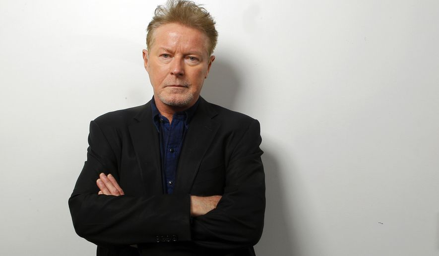 """FILE - In this Sept. 17, 2015 photo, Don Henley poses at the CMT Studios in Nashville, Tenn., to promote his new country album, """"Cass County,"""" out on Sept. 25. (Photo by Wade Payne/Invision/AP)"""