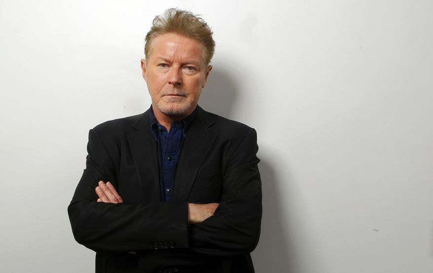"FILE - In this Sept. 17, 2015 photo, Don Henley poses at the CMT Studios in Nashville, Tenn., to promote his new country album, ""Cass County,"" out on Sept. 25. (Photo by Wade Payne/Invision/AP)"