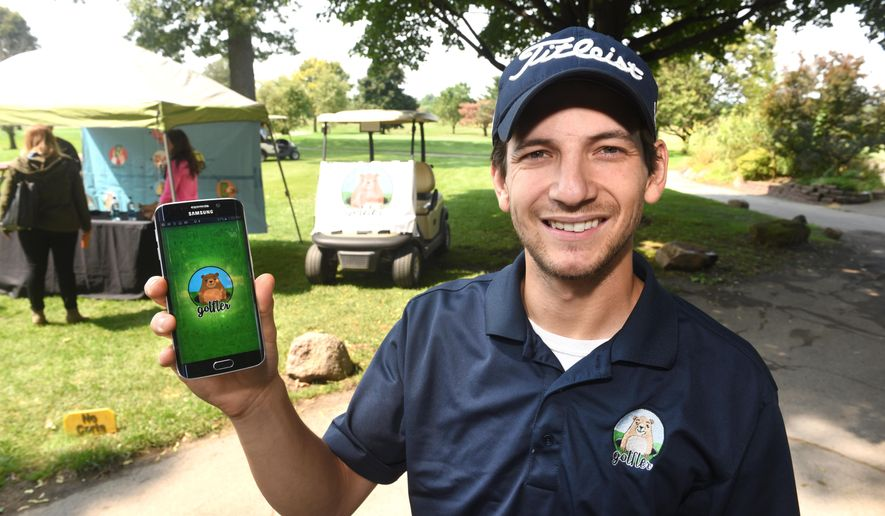 ADVANCE FOR USE SUNDAY, SEPT. 27 - In this photo taken Aug. 28, 2015, Jason Pearsall, President and CLO (Chief Legal Officer), of Golfler, demonstrates the Golfler, high tech app at Rackham Gold Course in Huntington Woods, Mich. Some of the features of the app include a 3-D range finder, shot-plotting, a built-in communicator to chat with other golfers, maps of nearly 1,300 U.S. courses, weather forecasts and the ability to allow a golfer to order food and equipment deliveries. The delivery service has a fee that allows the company and the golf course make money.  (Max Ortiz/Detroit News via AP)  DETROIT FREE PRESS OUT; HUFFINGTON POST OUT; MANDATORY CREDIT