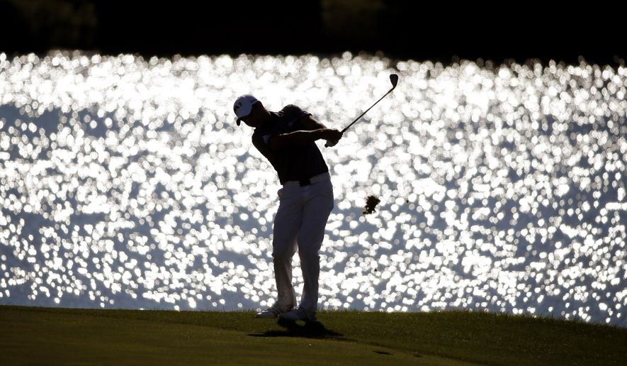 Jason Day, of Australia, hits his approach shot on the 15th fairway during the final round of the BMW Championship golf tournament at Conway Farms Golf Club, Sunday, Sept. 20, 2015, in Lake Forest, Ill. (AP Photo/Charles Rex Arbogast)