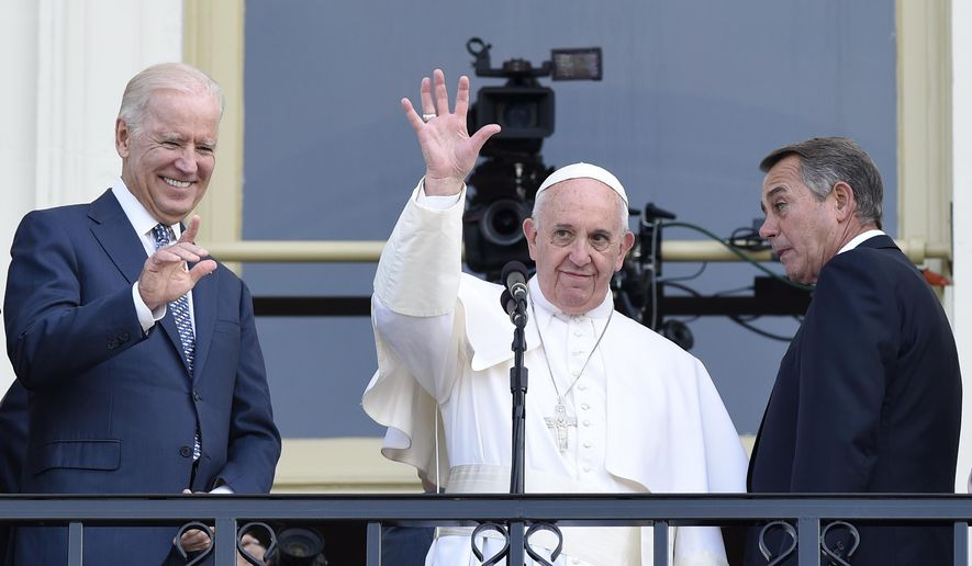 Pope Francis, flanked by Vice President Joe Biden and House Speaker John Boehner of Ohio, waves to the crowd on Capitol Hill in Washington, Thursday, Sept. 24, 2015, as they stand on the Speaker's Balcony on Capitol Hill, after the pope addressed a joint meeting of Congress inside. (AP Photo/Susan Walsh)