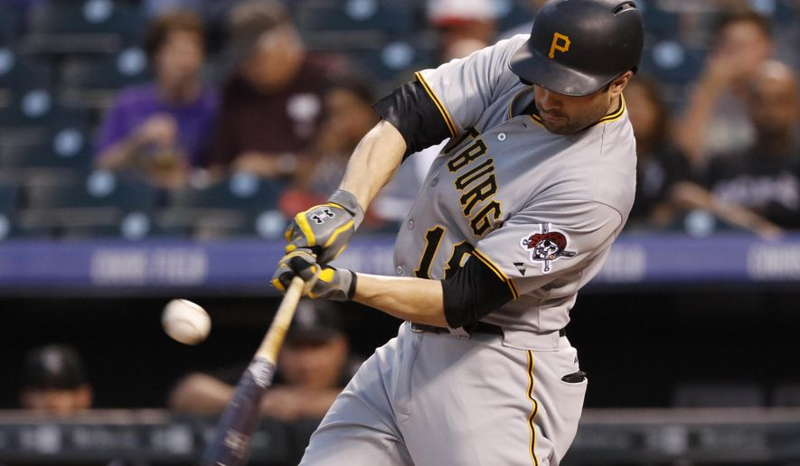 Pittsburgh Pirates' Neil Walker hits a two RBI single against the Colorado Rockies during the first inning of a baseball game Wednesday, Sept. 23, 2015, in Denver.  (AP Photo/Jack Dempsey)
