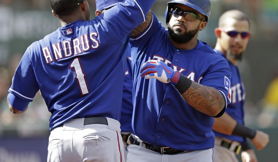 Texas Rangers' Prince Fielder, right front, celebrates with Elvis Andrus (1) after hitting a two-run home run off Oakland Athletics' Cody Martin during the eighth inning of a baseball game Thursday, Sept. 24, 2015, in Oakland, Calif. (AP Photo/Ben Margot)