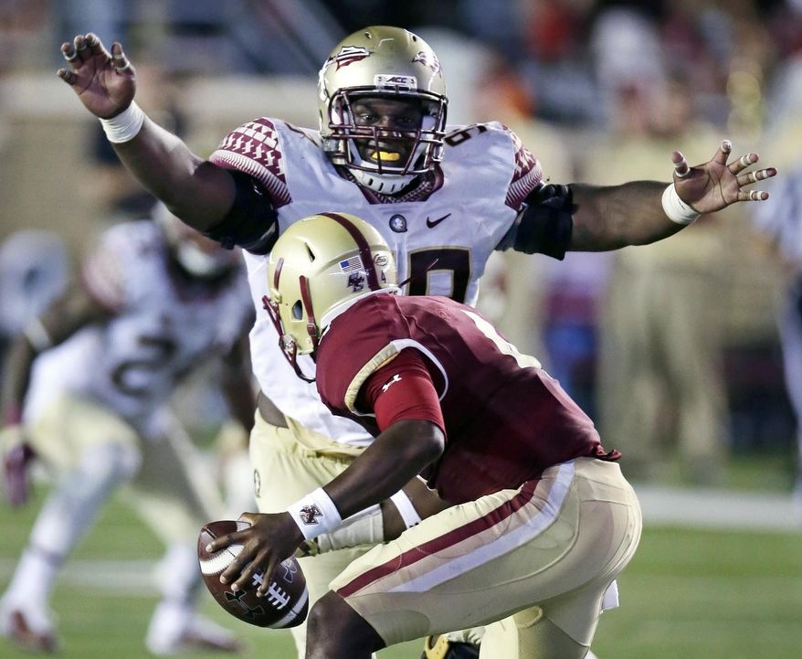 FILE - In this Sept. 18, 2015, file photo, Florida State defensive tackle Nile Lawrence-Stample tracks down Boston College quarterback Darius Wade on a sack during the second half of an NCAA college football game in Boston. Florida State's bye week might be coming at a good time. The defense is playing well but lack of consistency on offense has been a problem for the No. 10 Seminoles. (AP Photo/Charles Krupa, File)
