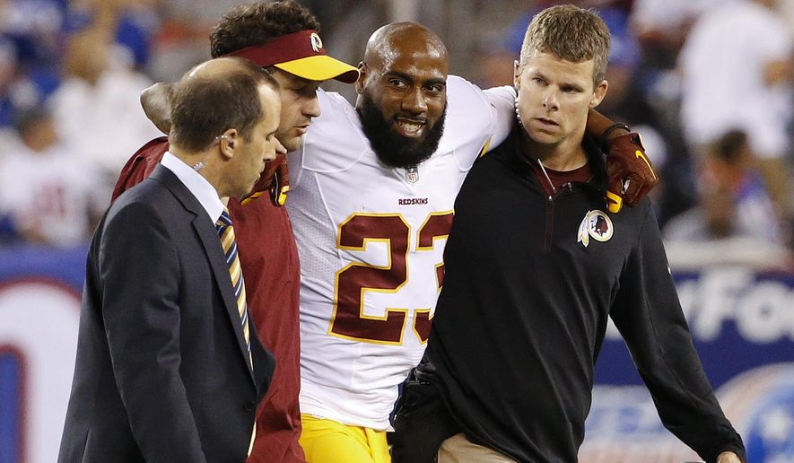 Washington Redskins cornerback DeAngelo Hall (23) is helped off the field during the second half an NFL football game against the New York Giants Thursday, Sept. 24, 2015, in East Rutherford, N.J. (AP Photo/Kathy Willens)