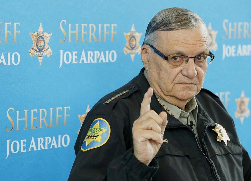 FILE - In this Dec. 18, 2013, file photo, Maricopa County Sheriff Joe Arpaio speaks at a news conference at the Sheriff's headquarters in Phoenix. The sheriff faces a new round of contempt-of-court hearings Thursday, Sept. 24, 2015, for openly disobeying a judge's order to stop carrying out his signature immigration patrols. (AP Photo/Ross D. Franklin, File)
