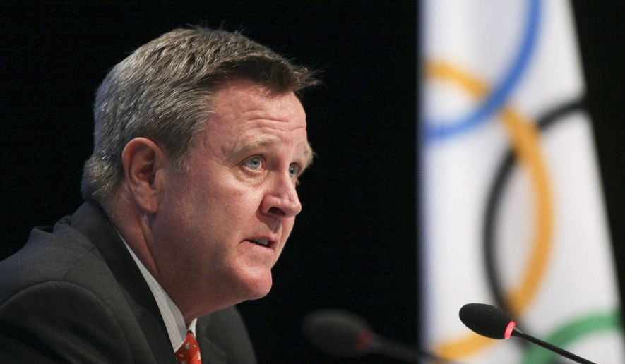 FILE - In this May 24, 2012, file photo, Scott Blackmun discusses with the media an agreement between the International Olympic Committee and the U.S. Olympic Committee at the SportAccord conference in Quebec City. Blackmun, the leader of the U.S. Olympic Committee, blamed Boston's aborted attempt to bid for the 2024 Olympics on a lack of public support that forced him to eat a big slice of humble pie. Blackmun gave his most candid public comments yet about the ups and downs of the bid process at the annual gathering of the U.S. Olympic Assembly. (Francis Vachon/The Canadian Press via AP, File)