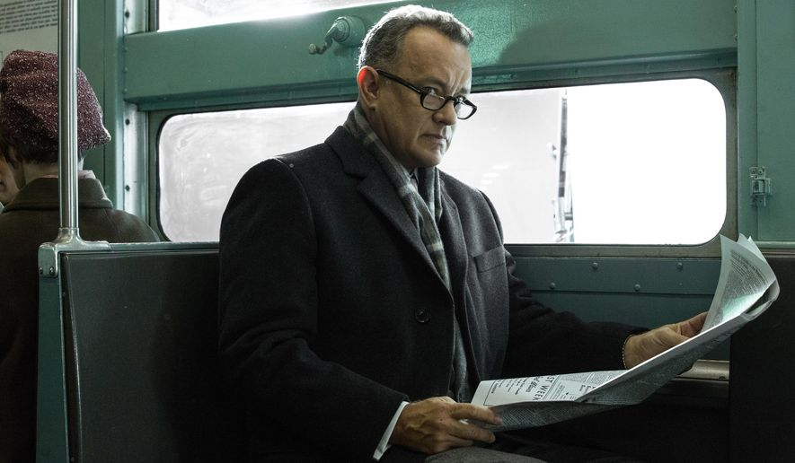 """In this image released by DreamWorks II Distribution Co., Tom Hanks portrays Brooklyn lawyer James Donovan in a scene from the Steven Spielberg film, """"Bridge of Spies."""" The film will premiere at the 53rd New York Film Festival before opening in U.S. theaters on Oct. 16, 2015. (Jaap Buitendijk/DreamWorks II Distribution Co. via AP)"""