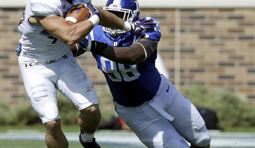 Duke's Carlos Wray, right, reaches to tackle Northwestern's Dan Vitale during the second half of an NCAA college football game in Durham, N.C., Saturday, Sept. 19, 2015. Northwestern won 19-10. (AP Photo/Gerry Broome)