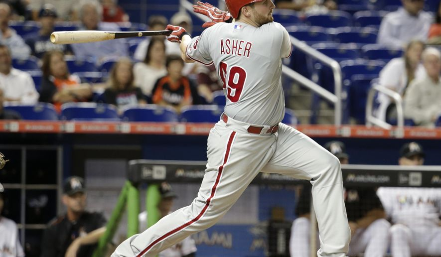 Philadelphia Phillies' Alec Asher follows through on a single during the third inning of a baseball game against the Miami Marlins, Thursday, Sept. 24, 2015, in Miami. (AP Photo/Lynne Sladky)