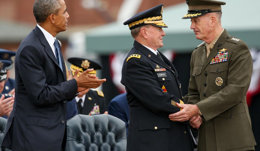 President Barack Obama watches as newly sworn-in Joint Chiefs Chairman Gen. Joseph Dunford Jr., right, shakes hands with retiring Joint Chiefs Chairman Gen. Martin Dempsey during his Armed Forces Full Honors Retirement Ceremony for Dempsey, Friday, Sept. 25, 2015, at Fort Myer in Arlington, Va. (AP Photo/Andrew Harnik)