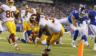 Washington Redskins running back Matt Jones (31) fumbles the ball near the end zone as New York Giants' Trevin Wade (31) chases him during the second half an NFL football game Thursday, Sept. 24, 2015, in East Rutherford, N.J. (AP Photo/Kathy Willens)
