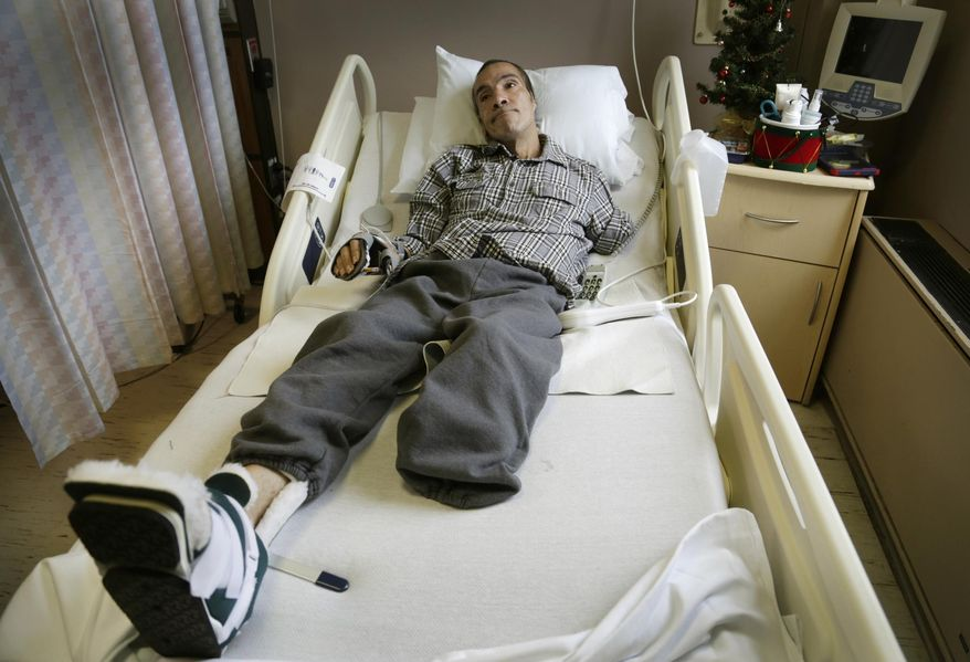 FILE--In this Dec. 9, 2014 file photo, Steve Constantine, who suffered a near fatal dog mauling in October of 2014 is shown in a hospital bed in Detroit. Derick Felton, a Detroit dog owner who pleaded guilty in the brutal mauling of a man who was attacked while feeding a pack of pit bulls, faces sentencing Friday, Sept. 24, 2015. Constantine lost most of his left arm, his left leg below the knee and his left ear last fall. (Mandi Wright/Detroit Free Press via AP)  DETROIT NEWS OUT; TV OUT; MAGS OUT; NO SALES; MANDATORY CREDIT DETROIT FREE PRESS