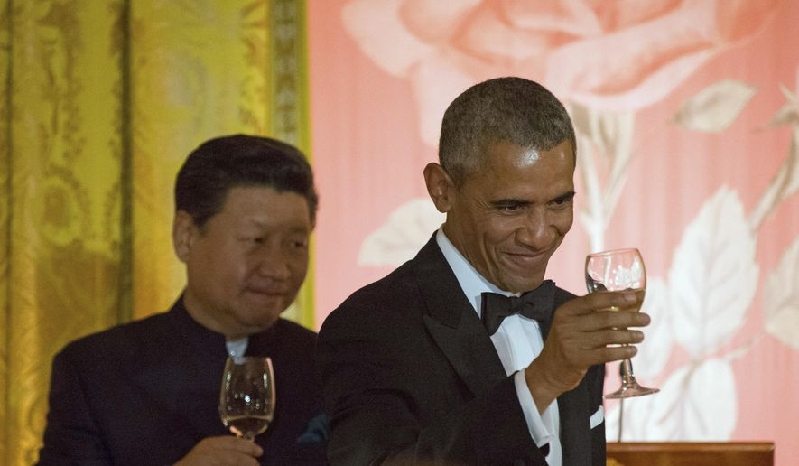 Chinese President Xi Jinping and President Barack Obama toast during a State Dinner, Friday, Sept. 25, 2015, in the East Room of the White House in Washington. (AP Photo/Andrew Harnik)