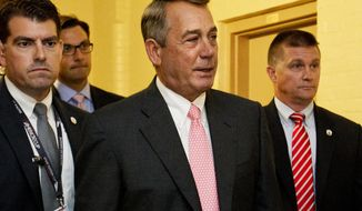 House Speaker John Boehner of Ohio, center, leaves a meeting with House Republicans on Capitol Hill in Washington, Friday, Sept. 25, 2015. In a stunning move, Boehner informed fellow Republicans on Friday that he would resign from Congress at the end of October, giving up his top leadership post and his seat in the House in the face of hardline conservative opposition. (AP Photo/Jacquelyn Martin)