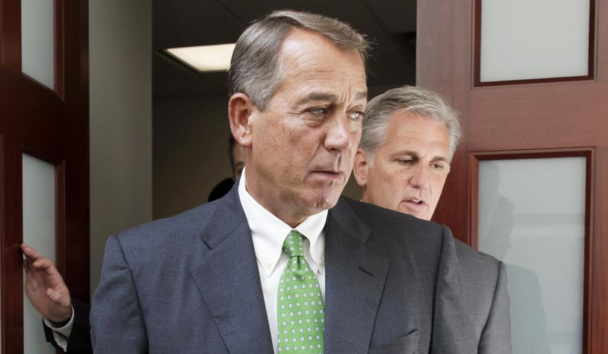 In this Sept. 11, 2014 file photo, House Speaker John Boehner of Ohio, left, followed by House Majority Leader Kevin McCarthy of Calif., emerge from a meeting on Capitol Hill in Washington. In a stunning move, Boehner informed Republicans that he would step down at the end of October.  (AP Photo/J. Scott Applewhite, File)