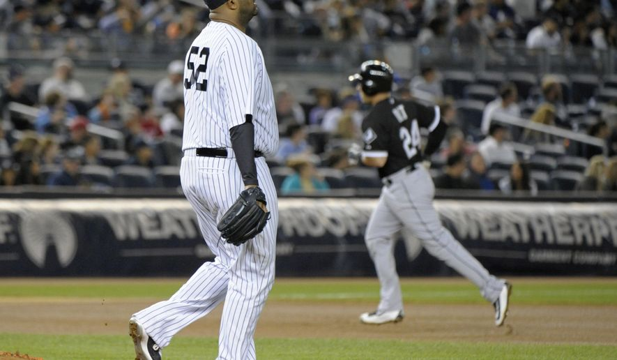 New York Yankees pitcher CC Sabathia (52) reacts as Chicago White Sox's Mike Olt, right, rounds the bases with a home run during the seventh inning of a baseball game Friday, Sept. 25, 2015, at Yankee Stadium in New York. (AP Photo/Bill Kostroun)