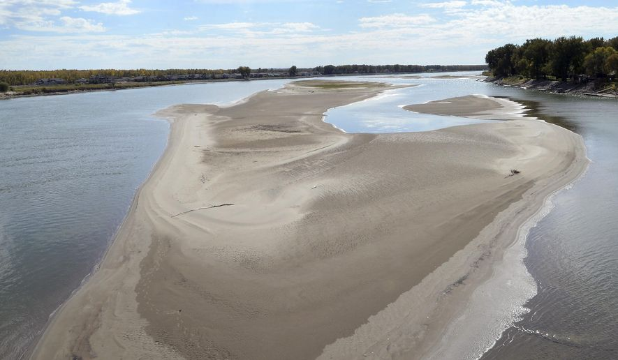 The Sept. 22, 2015 photo shows a Missouri River sandbar, south of the Expressway bridge near Bismarck, N.D., that  has been growing lately as water levels have dropped. As the water levels drop in the Missouri River, boaters are becoming frustrated with the Corps of Engineers' decision to decrease the release of water from the Garrison Dam. (Will Kincaid/The Bismarck Tribune via AP) MANDATORY CREDIT