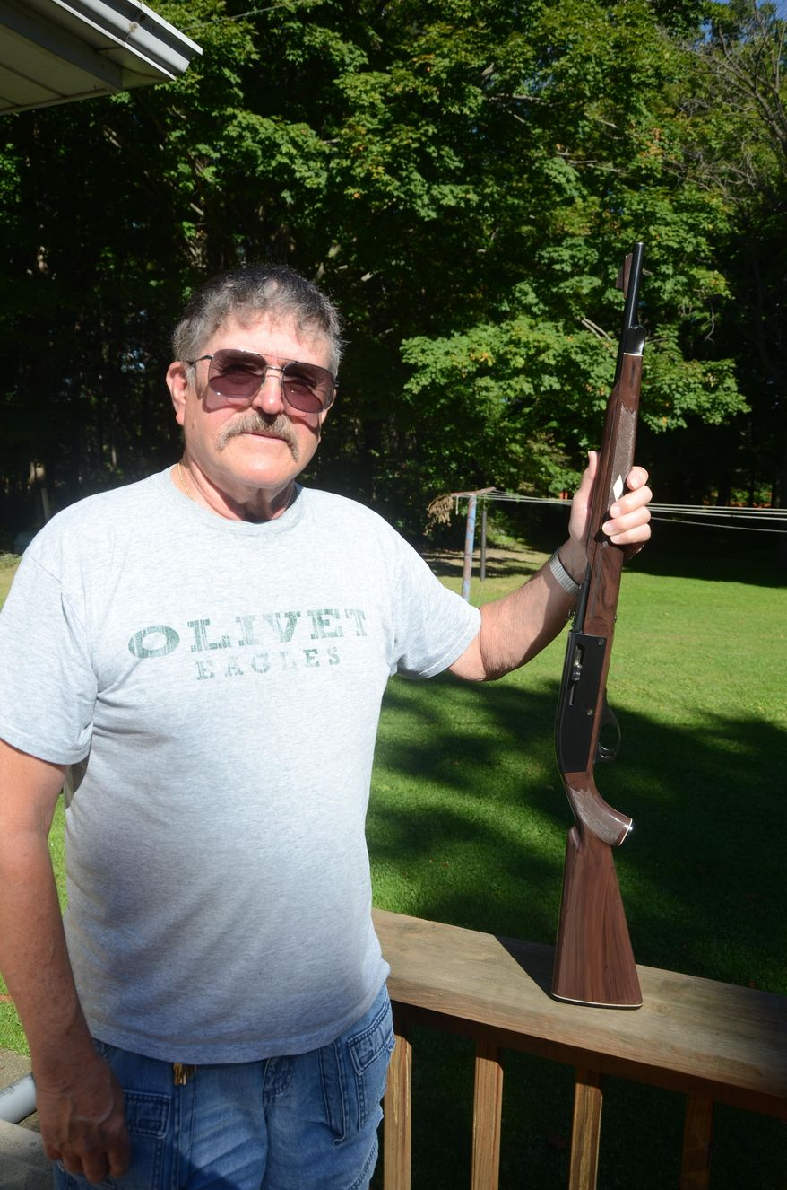 In this photo taken Wednesday, Sept. 23, 2015, Richard Montague, 72, poses in Lee Township, Mich., with the rifle which was stolen Sept. 1, 1982, and just recently returned after police recovered it in Tennessee.  (Trace Christenson/Battle Creek Enquirer via AP)  NO SALES; MANDATORY CREDIT