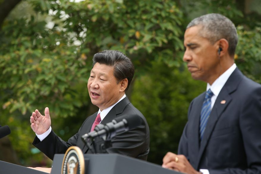 President Barack Obama and Chinese President Xi Jinping participate in a joint news conference in the Rose Garden of the White House in Washington, Friday, Sept. 25, 2015. (AP Photo/Andrew Harnik)