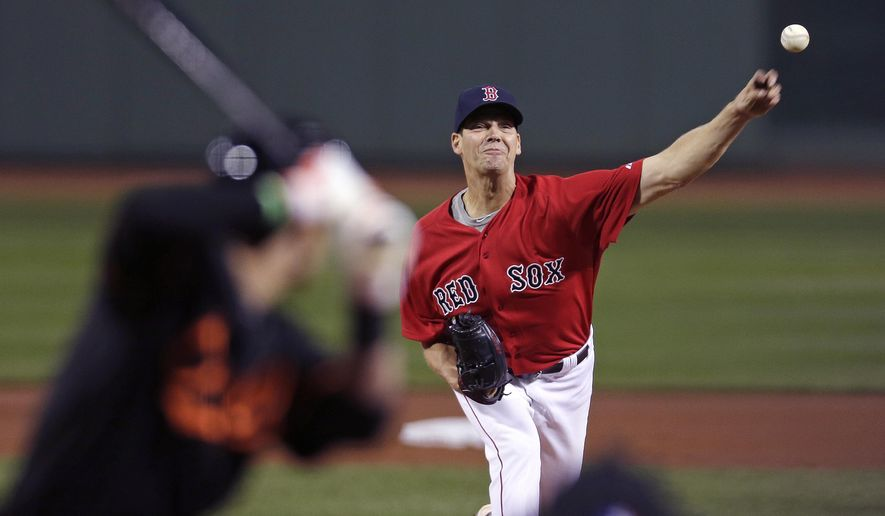 Boston Red Sox starting pitcher Rich Hill delivers during the first inning of a baseball game against the Baltimore Orioles at Fenway Park in Boston, Friday, Sept. 25, 2015. (AP Photo/Charles Krupa)