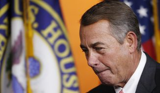 House Speaker John Boehner of Ohio leaves a news conference on Capitol Hill in Washington on Sept. 25, 2015, after announcing he would resign from Congress at the end of October. (Associated Press) **FILE**