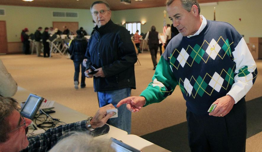 FILE - In this Nov. 6, 2012, file photo, U.S. House Speaker John Boehner, right, presents his photo ID before casting his general election ballot at Ronald Reagan Lodge near his home in West Chester Township, Ohio, in the district he's represented since 1991 in western Ohio, north of Cincinnati and west of Columbus. Boehner abruptly informed fellow Republicans on Friday, Sept. 25, 2015, that he would resign from Congress at the end of October. (AP Photo/Al Behrman, File)