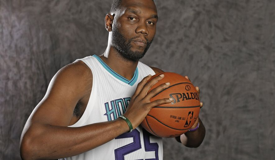 Charlotte Hornets' Al Jefferson poses for a photo during the NBA basketball team's media day in Charlotte, N.C., Friday, Sept. 25, 2015 . (AP Photo/Chuck Burton)