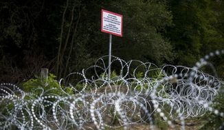 Razor wire is photographed during the installation of a temporary fence at the border between Hungary and Croatia near Magyarboly, 218 kms south of Budapest, Hungary, Thursday, Sept. 24, 2015.  (Janos Marjai/MTI via AP)