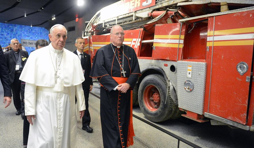 Pope Francis walks past a fire truck, damaged in the attacks of Sept. 11, 2001, while visiting the 9/11 Museum, Friday, Sept. 25, 2015 in New York.  (Susan Watts/New York Daily News via AP, Pool)