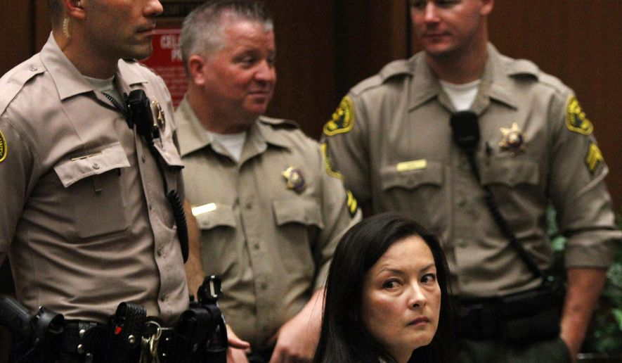 FILE - In this May 15, 2013 file photo, Kelly Soo Park looks back at the gallery as opening motions are made in her murder trial. Park was then charged with the 2008 killing of aspiring model and actress Juliana Redding. Los Angeles prosecutors say Park and Dr. Munir Uwaydah are both charged in a conspiracy to fraudulently bill insurance companies $150 million.   (Bob Chamberlin/Los Angeles Times via AP, Pool, File)