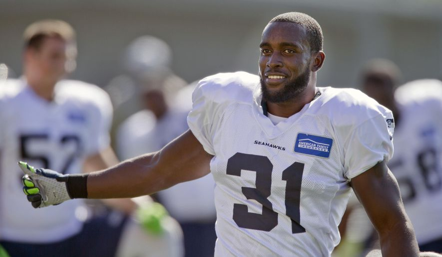 Seattle Seahawks' Kam Chancellor (31) attends NFL football practice for the first time after holding out over a contract dispute, on Wednesday, Sept. 23, 2015. at the team headquarters in Renton, Wash. (AP Photo/John Froschauer)