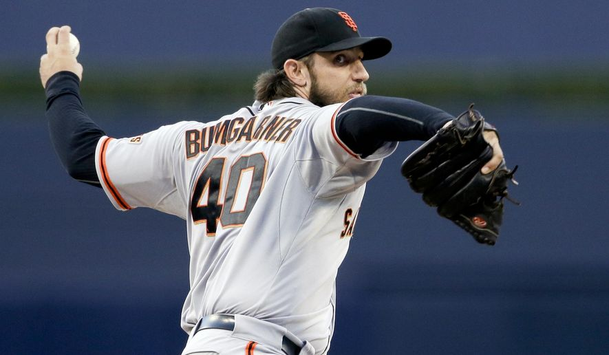 San Francisco Giants starting pitcher Madison Bumgarner winds up during the first inning of a baseball game against the San Diego Padres on Thursday, Sept. 24, 2015, in San Diego. (AP Photo/Gregory Bull)