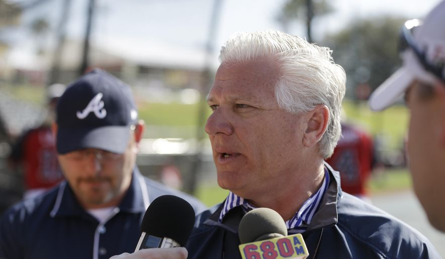 FILE - In this March 11, 2014, file photo, then-Atlanta Braves Executive Vice President and General Manager Frank Wren meets the media before their spring exhibition baseball game against the Philadelphia Phillies in Kissimmee, Fla. The Red Sox have hired former Atlanta Braves general manager Frank Wren as senior vice president of baseball operations, a day after Mike Hazen was promoted to general manager. Boston's move, announced Friday, Sept. 25, 2015, was the latest change made by Dave Dombrowski, who was hired in August as president of baseball operations.(AP Photo/Carlos Osorio, File)