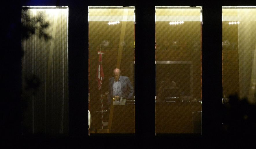 FIFA President Sepp Blatter stands inside an office at FIFA headquarters in Zurich, Switzerland, Friday, Sept. 25, 2015. Blatter was placed under criminal investigation by Swiss authorities on Friday as a probe into soccer corruption reached the highest levels and left his grip on the top job in peril. (Walter Bieri/Keystone via AP)