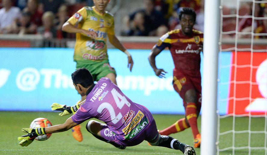 Santa Tecla goalkeeper Juan Trinidad (24) blocks a Real Salt Lake shot during a CONCACAF Champions League soccer match Thursday, Sept. 24, 2015, in Sandy, Utah. (Francisco Kjolseth/The Salt Lake Tribune via AP)