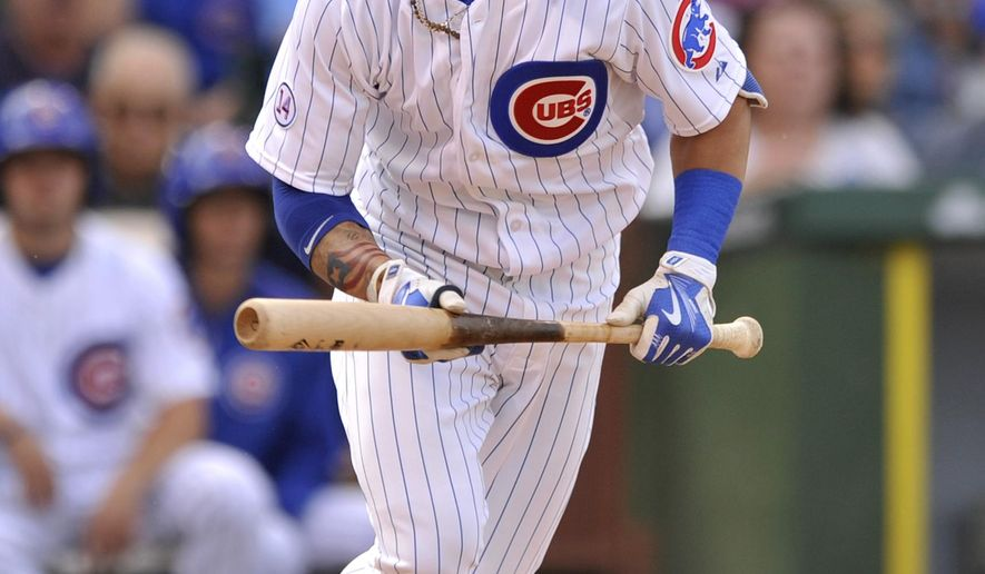 Chicago Cubs' Javier Baez bunts before being thrown out at first base during the eighth inning of a baseball game against the Pittsburgh Pirates, Friday, Sept. 25, 2015, in Chicago. Pittsburgh won 3-2. (AP Photo/Paul Beaty)