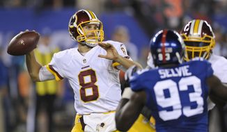 Washington Redskins quarterback Kirk Cousins (8) throws a pass during the first half an NFL football game against the New York Giants Thursday Sept. 24, 2015, in East Rutherford, N.J. (AP Photo/Bill Kostroun)