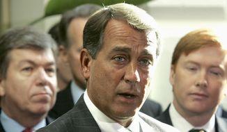 Then-Incoming House Minority Leader John Boehner of Ohio, center. (AP Photo/Lawrence Jackson, File)