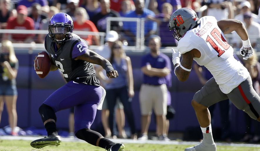 FILE - In this Oct. 25, 2014, file photo, TCU quarterback Trevone Boykin runs from Texas Tech linebacker Pete Robertson during an NCAA college football game in Fort Worth, Texas. The Horned Frogs had their way with the Red Raiders last season in Fort Worth, beating Texas Tech 82-27. The teams meet on Saturday in Lubbock. (AP Photo/Tony Gutierrez, File)