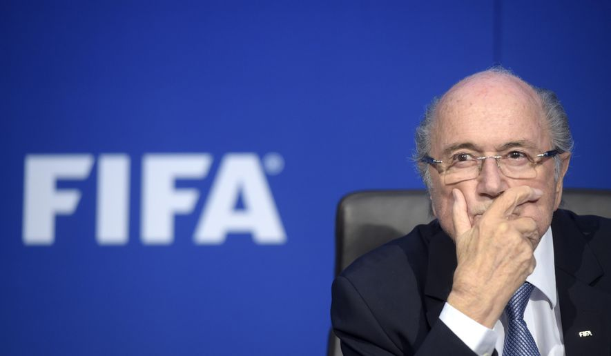FILE - In July 20, 2015 file photo FIFA president Sepp Blatter attends a news conference following the extraordinary FIFA Executive Committee at the  headquarters in Zurich, Switzerland. On Friday, Sept. 25, 2015 Swiss attorney general opened criminal proceedings against FIFA President Sepp Blatter.   (Ennio Leanza/Keystone via AP)
