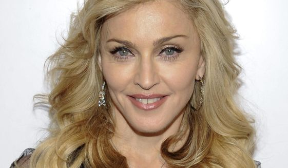 This April 12, 2012, file photo shows singer Madonna arriving at Macy's Herald Square to launch her new fragrance in New York. (AP Photo/Evan Agostini, File)
