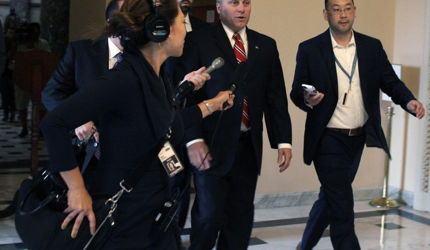 House Majority Whip Steve Scalise of La. is pursued by reporters on Capitol Hill in Washington, Friday, Sept. 25, 2015, after news of House Speaker John Boehner's resignation. (AP Photo/Lauren Victoria Burke)