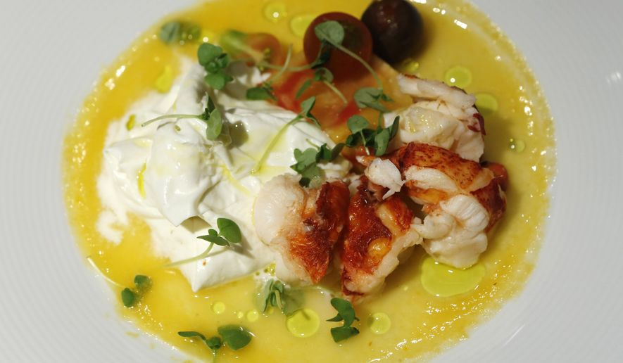 In this Sept. 17, 2015 photo, lobster with burrata in fresh olive oil with heirloom tomatoes and fresh herbs is displayed after being prepared for owner Lidia Bastianich and restaurateur Angelo Vivolo at Felidia restaurant in New York. The pair have been chosen to prepare meals for Pope Francis. (AP Photo/Kathy Willens)