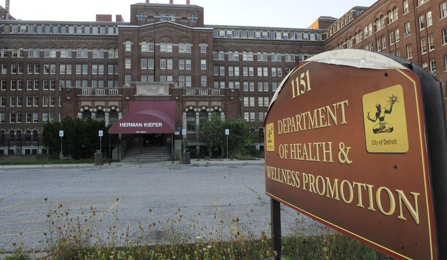 This photo taken Wednesday, Sept. 23, 2015, shows the exterior of the The Herman Kiefer health complex in Detroit. The City Council could sign off as early as next week on a massive, eight-year development agreement for the shuttered  complex. The city has partnered with Herman Kiefer Development LLC, a group led by New York-based Studio Castellano, to save, rehabilitate and creatively reuse the building. (David Coates/Detroit News via AP)  DETROIT FREE PRESS OUT; HUFFINGTON POST OUT; MANDATORY CREDIT